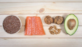 Sources of omega 3 fatty acids: flaxseeds, avocado, salmon and walnuts Stock Images