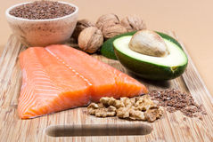 Sources of omega 3 fatty acids: flaxseeds, avocado, salmon and walnuts Stock Photos