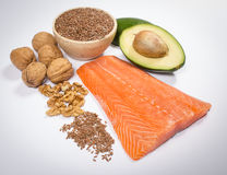 Sources of omega 3 fatty acids: flaxseeds, avocado, salmon and walnuts. Sources of omega 3 fatty acids Stock Image