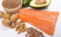 Sources of omega 3 fatty acids: flaxseeds, avocado, salmon and walnuts. Sources of omega 3 fatty acids Royalty Free Stock Photos