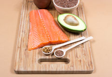 Sources of omega 3 fatty acids: flaxseeds, avocado, salmon and walnuts. Sources of omega 3 fatty acids Royalty Free Stock Images