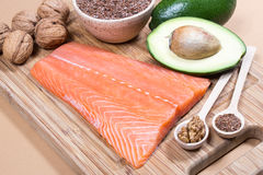 Sources of omega 3 fatty acids: flaxseeds, avocado, salmon and walnuts. Sources of omega 3 fatty acids Stock Images