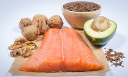 Sources of omega 3 fatty acids: flaxseeds, avocado, salmon and walnuts. Sources of omega 3 fatty acids Stock Photography