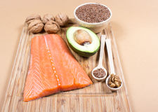 Sources of omega 3 fatty acids: flaxseeds, avocado, salmon and walnuts Royalty Free Stock Photo