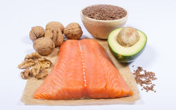 Sources of omega 3 fatty acids: flaxseeds, avocado, salmon and walnuts. Sources of omega 3 fatty acids Royalty Free Stock Photo