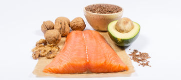 Sources of omega 3 fatty acids: flaxseeds, avocado, salmon and walnuts. Sources of omega 3 fatty acids Royalty Free Stock Photography