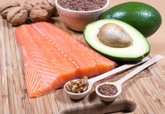 Sources of omega 3 fatty acids: flaxseeds, avocado, salmon and walnuts. Sources of omega 3 fatty acids royalty free stock image