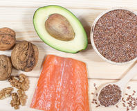 Sources of omega 3 fatty acids: flaxseeds, avocado, salmon and walnuts Royalty Free Stock Image