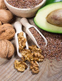 Sources of omega 3 fatty acids: flaxseeds, avocado and walnuts Stock Photos