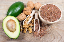 Sources of omega 3 fatty acids: flaxseeds, avocado and walnuts Stock Image