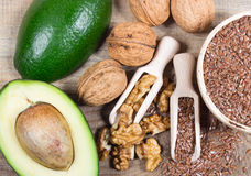 Sources of omega 3 fatty acids: flaxseeds, avocado and walnuts Royalty Free Stock Image