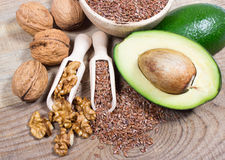Sources of omega 3 fatty acids: flaxseeds, avocado and walnuts Royalty Free Stock Photography
