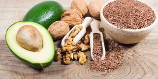 Sources of omega 3 fatty acids: flaxseeds, avocado and walnuts. Sources of omega 3 fatty acids Royalty Free Stock Images