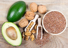 Sources of omega 3 fatty acids: flaxseeds, avocado and walnuts. Sources of omega 3 fatty acids Royalty Free Stock Photos