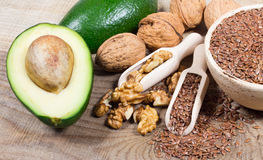 Sources of omega 3 fatty acids: flaxseeds, avocado and walnuts. Sources of omega 3 fatty acids Royalty Free Stock Photography