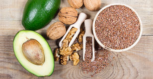 Sources of omega 3 fatty acids: flaxseeds, avocado and walnuts. Sources of omega 3 fatty acids Stock Images