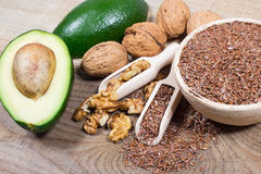 Sources of omega 3 fatty acids: flaxseeds, avocado and walnuts. Sources of omega 3 fatty acids Stock Photo