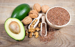 Sources of omega 3 fatty acids: flaxseeds, avocado and walnuts. Sources of omega 3 fatty acids Stock Photos
