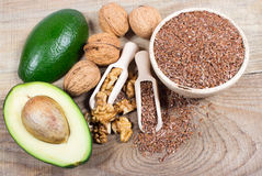 Sources of omega 3 fatty acids: flaxseeds, avocado and walnuts. Sources of omega 3 fatty acids Stock Image