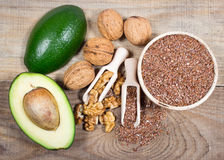 Sources of omega 3 fatty acids: flaxseeds, avocado and walnuts Royalty Free Stock Images