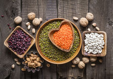 Sources of vegetable protein are various legumes and nuts. Top view Royalty Free Stock Image