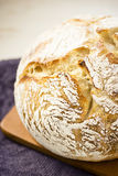 Sourdough Boule or Loaf of Bread on Cutting Board Royalty Free Stock Photos
