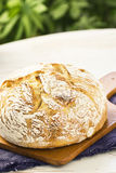 Sourdough Boule or Loaf of Bread on Cutting Board Royalty Free Stock Image
