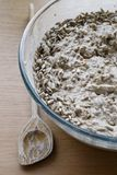Sourdough bread dough raw in a bowl. Sourdough bread dough raw with sunflower-seeds in a glass bowl on a kitchen top. Selective focus royalty free stock image