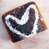 Sourdough bread and a heart made from flour Stock Photography