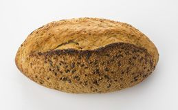 Top View of Golden Brown Sourdough Bread  on White Background Shot in Studio. Sourdough bread is made by the fermentation of dough using naturally occurring Royalty Free Stock Images