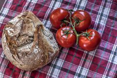 Sourdough bread and tomatoes Royalty Free Stock Photography