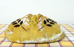 Sourdough bread with turmeric decorated with wheat spice Stock Photos