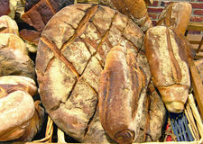 Sourdough breads in wicker basket. Stock Photos