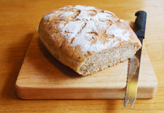 Sourdough on Chopping Board with Knife Royalty Free Stock Photos