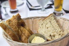 Sourdough and Herb Bread in Basket Stock Images