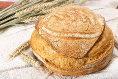 Sourdough homemade round white wheat bread close up. Sourdough homemade round white wheat bread royalty free stock photos