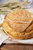 Sourdough homemade round white wheat bread close up. Sourdough homemade round white wheat bread with slices on table close up stock images