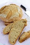 Sourdough homemade bread with sesame seeds. Sourdough sliced bread with sesame seeds. Baked at home, 100% natural Stock Image