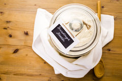 Sourdough starter. In large glass jar on the table Royalty Free Stock Photos