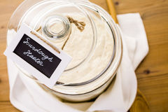 Sourdough starter. In large glass jar on the table Stock Photos
