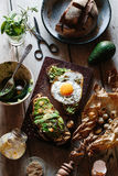 Sourdough Toast with Tahini, Avocado, Fried Egg and Roasted Garl Stock Photography