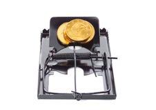 Souricière à clapet avec des pièces de monnaie Photographie stock