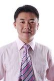 Sourire asiatique d'homme d'affaires Photo stock