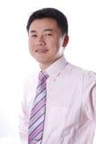 Sourire asiatique d'homme d'affaires Photographie stock libre de droits