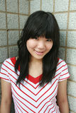 Sourire asiatique de fille Photographie stock libre de droits