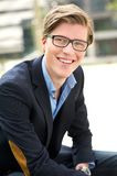Sourire attrayant de jeune homme Photos libres de droits