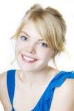 sourire bleu blond de fille Images stock