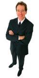 sourire d'aîné d'isolement par homme d'affaires réussi Image stock