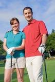 Sourire de golfeurs à l'appareil-photo - verticale Images stock