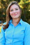 Sourire de jeune femme Photographie stock